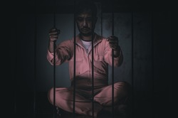 Asian man desperate at the iron prison,prisoner concept,thailand people,Hope to be free,Serious prisoners imprisoned in the prison