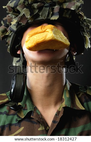 "asian man dressed as a ""food"" soldier"