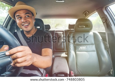 Asian man driving car and look back. #748803805