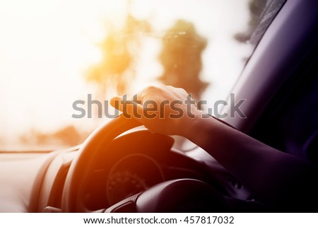 asian man driving hands close...