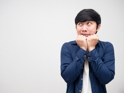 Asian man gesture afraid and looking at copy space white isolated
