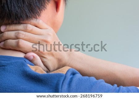 Asian man having neck pain and free space for text