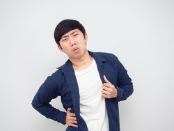 Asian man hurt his waist pain face portrait white background