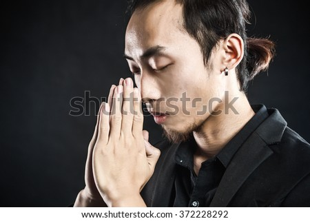 Asian man in a white shirt with grey suit in studio lighting in grey background #372228292