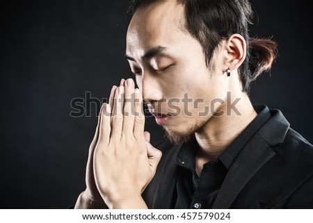 Asian man in a white shirt with grey suit in studio lighting in grey background #457579024