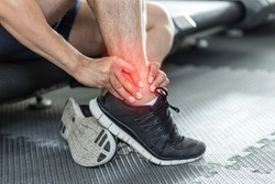 Asian man injury ankle pain after training running workout in gym feeling so pain,Healthcare Concept