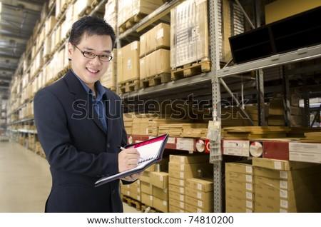 asian man inside a factory