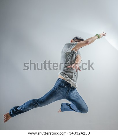 Asian Man Jumping Pose Action #340324250