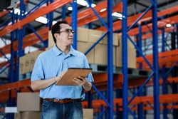 Asian man owner mananger of SME business warehouse storage