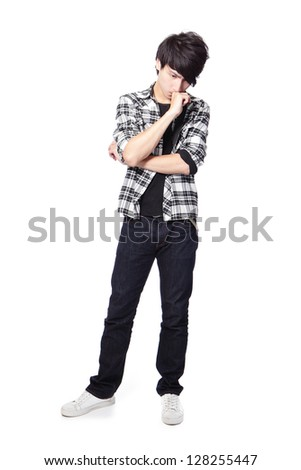 Asian man standing thoughtfully with arms ,full length