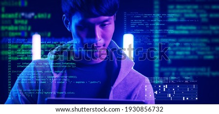 Asian man using computer with futuristic computer code preview, computer engineer program developer typing code, internet digital technology security concept.