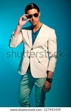 Asian man wearing suit and sunglasses. Summer fashion. Studio.