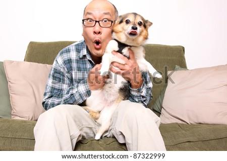 Asian man with pet dog.