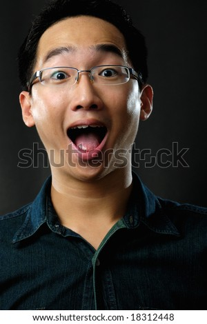 Asian man with surprised face