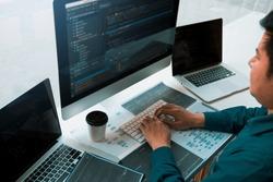 Asian man working code program developer computer web development working design software on desk in office.