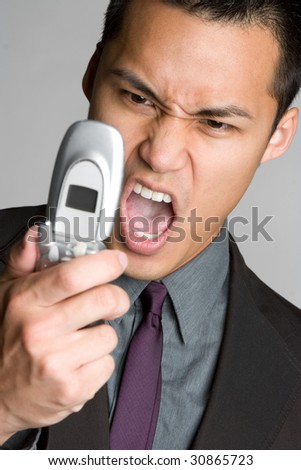 Asian Man Yelling into Phone