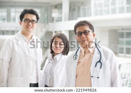 Asian medical team of doctors standing inside hospital building