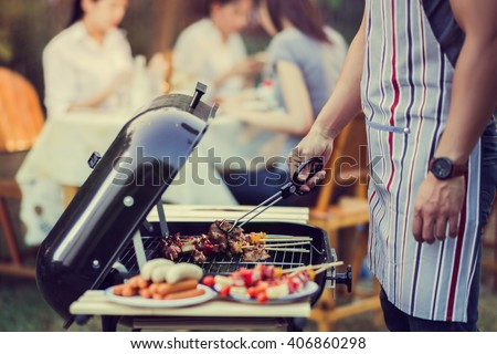 Asian men are cooking for a group of friends to eat barbecue #406860298