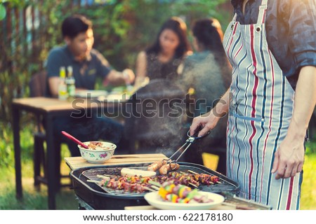 Asian men are cooking for a group of friends to eat barbecue #622178180