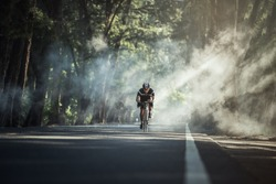 Asian men are cycling road bike in the morning