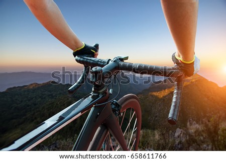 Asian men are cycling road bike in the the sunset,Silhouette of the cyclist on bike at sunset #658611766
