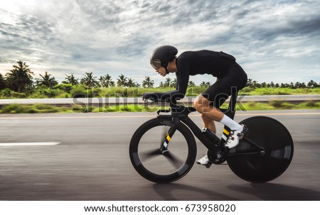 Asian men are cycling
