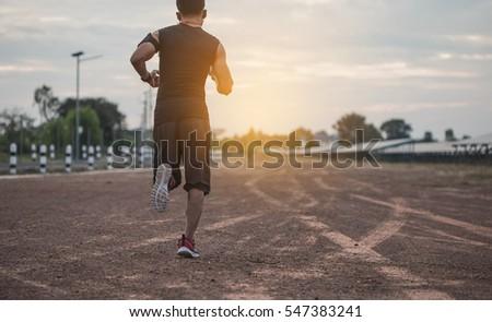 asian men are siluate jogging...