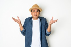 Asian men around the age of 27-35 are thinking and making faces, confused, not understanding, wondering with something. This photo was taken in the studio. With a white background.