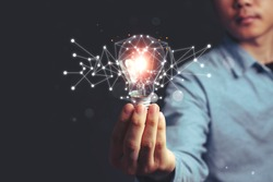 Asian Men holding light bulbs, ideas of new ideas with innovative technology and creativity. concept creativity, Branch with bulbs that shine glitter.