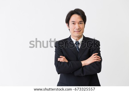 Shutterstock Asian middle age businessman
