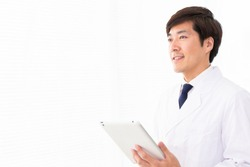 Asian middle age man in a white coat,Tablet computer