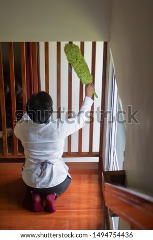 asian middle aged domestic helper woman cleaning apartment, doing housework, housekeeping service #1494754436