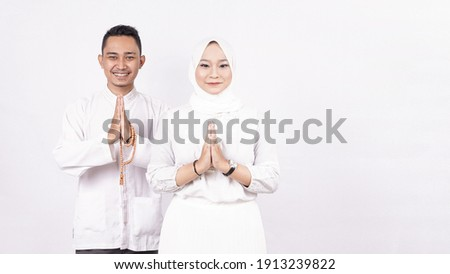 Asian moslem couple greeting gesture on ramadhan isolated