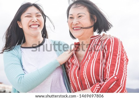 Asian mother and daughter having fun outdoor - Happy family people enjoying time togehter around city in Asia - Love, parenthood lifestyle, tender moments concept - Focus on faces #1469697806