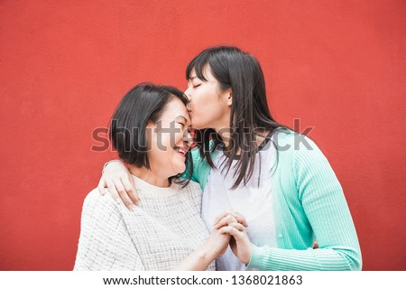 Asian mother and daughter having fun outdoor - Happy family people enjoying time togehter - Love, parenthood lifestyle, tender moments concept - Focus on faces #1368021863