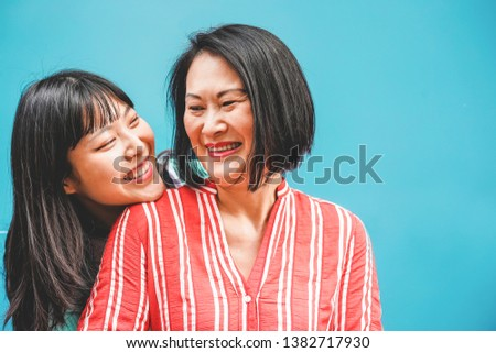 Asian mother and daughter having fun outdoor - Happy family people enjoying time togehter - Love, parenthood lifestyle, tender moments concept - Focus on faces #1382717930