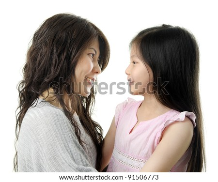 Asian mother and her daughter face to face on white background