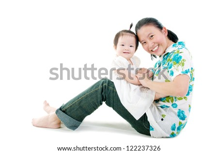 Asian mother having fun with her baby girl