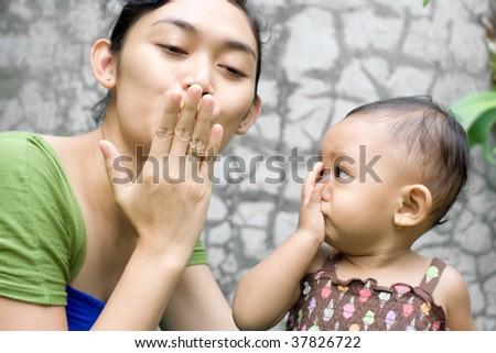 Asian Mother Teach her Baby Girl a Goodbye Kiss