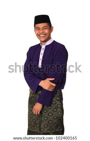 Asian muslim male with traditional Malay costume in smiling action, Baju Melayu