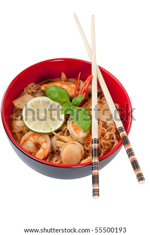 Asian noodle soup in front of white background