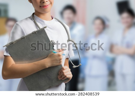 Asian nurse holding a steel file. To save the patient\'s situation hospital backdrop
