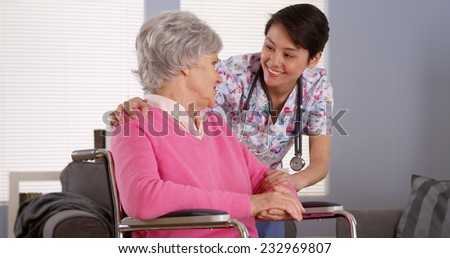 Asian nurse talking with Senior patient
