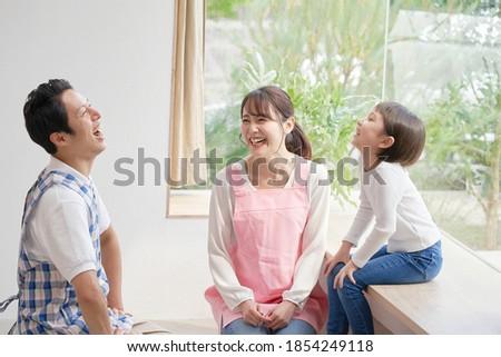 Asian nursery school teacher talking with the girl Stock photo ©