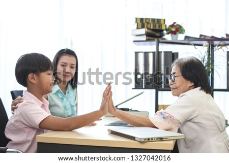 Asian mother son doctor