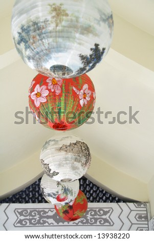Asian paper lanterns sway in an atrium
