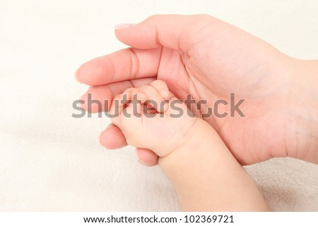 Asian parents and children hold hands in white background