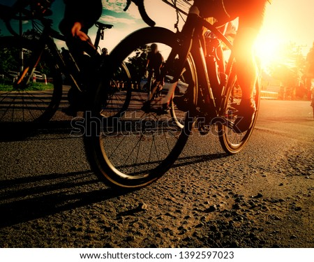 Asian person are cycling road bike to exercise . soft focus picture