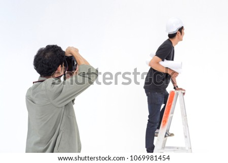 asian photographer is shooting a young man model in asian engineer concept in the studio for the stock photo.