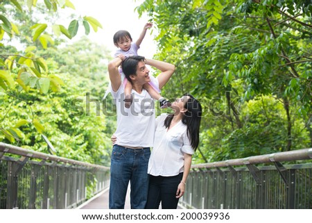 asian pregnant mother and family outdoor photo